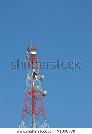 Modern cell and antenna with flat parabola on blue sky