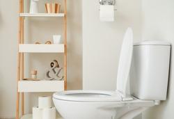 Modern ceramic toilet bowl in interior of restroom