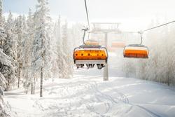 Modern chair ski lift in ski resort in Austria.