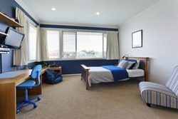 modern child's bedroom with white and blue decor
