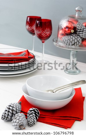 Modern christmas table setting with red accents, minimal, chic and casual
