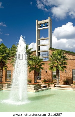 Modern Church Bell Tower and Fountain on a beautiful sunny day - stock photo