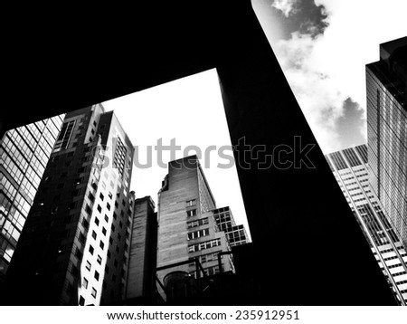 Modern city buildings and overhang outside in New York City with Instagram black and white effect filter.