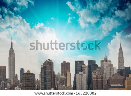 Modern city buildings and skyscrapers. Metropolis skyline with blue sky.