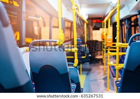 Modern city bus interior and seats. Public transport