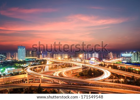 modern city interchange in nightfall beautiful overpass in shanghai