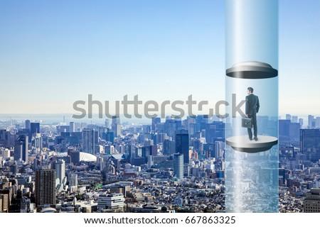 modern city skyline and futuristic elevator. space elevator concept. #667863325