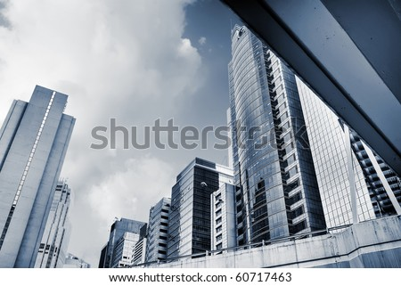 Modern city skyline with skyscrapers and office buildings.
