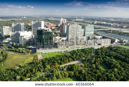 Modern city with green trees