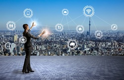 modern cityscape and business person, Internet of Things, Information Communication Technology, abstract image visual