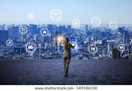 modern cityscape and business person, IoT(Internet of Things), ICT(Information Communication Technology), abstract image visual #549586330