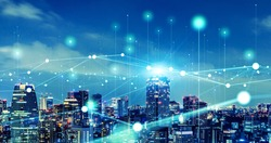 Modern cityscape and communication network concept. Telecommunication. IoT (Internet of Things). ICT (Information communication Technology). 5G. Smart city. Digital transformation.