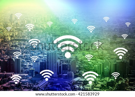 Photo of modern cityscape and wireless communication, internet of things, abstract image visual