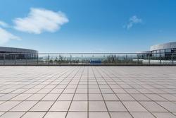 modern cityscape with empty brick floor against a sunny sky