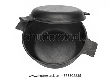 modern clean classic cast iron dutch oven or pot with pan cover isolated on white background. Black Bedroom Furniture Sets. Home Design Ideas