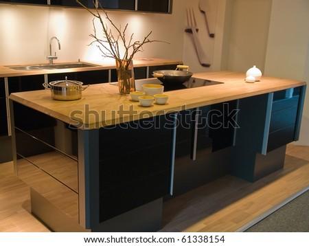 Modern clean design trendy kitchen made of black wooden elements