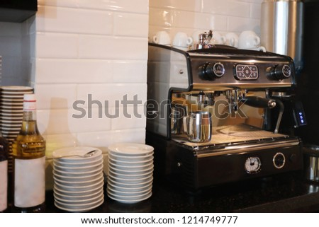 Modern coffee machine, white cups, saucers at counter in cafe #1214749777