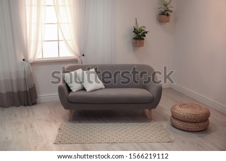 Modern comfortable sofa in stylish home interior #1566219112