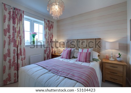 Modern compact bedroom detail dressed with brightly colored fabrics