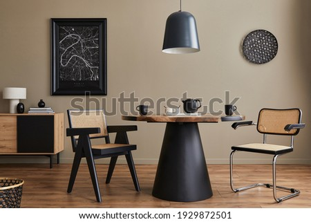 Modern composition of dining room interior with design wooden table, stylish chairs, decoration, teapot, cups, vessel, commode, black mock up poster map and elegant accessories in home decor. Template