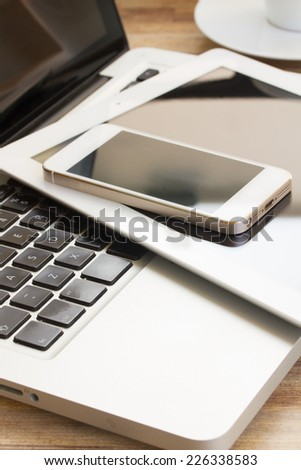 modern computer devices  - laptop, tablet and phone close up - Shutterstock ID 226338583