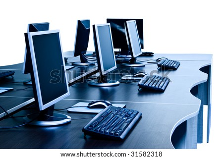 modern computers with LCD screens on desks isolated with clipping path