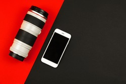 Modern concept comparing smartphone camera and DSLR lens and mobile phone, background, place for text, copy space