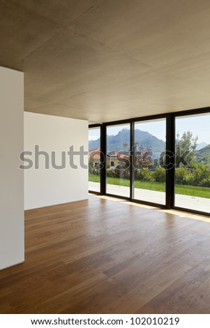 modern concrete house with hardwood floor, large window