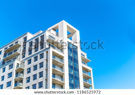 Modern condo buildings with huge windows in Montreal, Canada.  #1186525972
