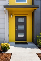 Modern condo entrance with yellow trim