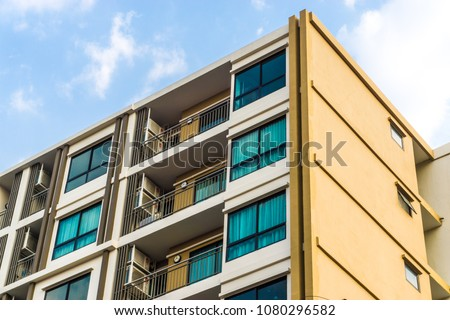 Modern condominium building in the city sky cloud background, Lowrise condo