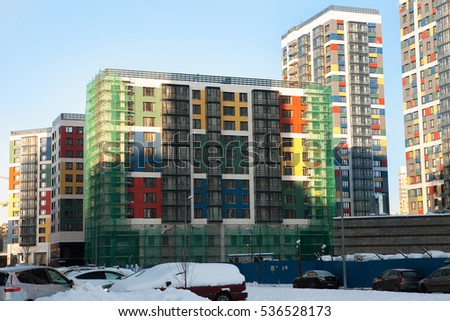 Modern condominium under construction. Colorful facades, commercial at the first floor. Ventilated facade system. Bright winter sunny day #536528173