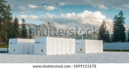 Modern container battery energy storage power plant system accompanied with solar panels and wind turbine system situated in nature with Mount St. Helens in background. 3d rendering. Stock photo ©