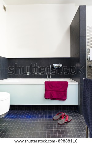 Modern contemporary bathroom design with towel
