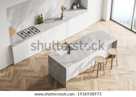 Modern contemporary design kitchen room interior. Dining island with stools. Panoramic windows. White and wood material. Oak parqueet. Top view. 3d rendering