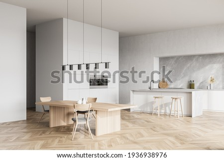 Modern contemporary design kitchen room interior. Dining table with chairs. Parquet flooring. White and wood material. 3d rendering