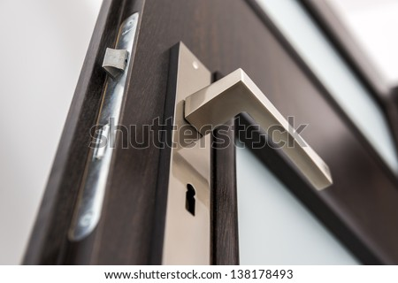 Modern, contemporary satin handle and keyhole detail #138178493