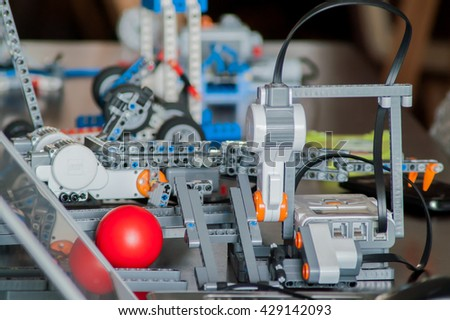 Stock Photo Modern controlled robot toy designer for children