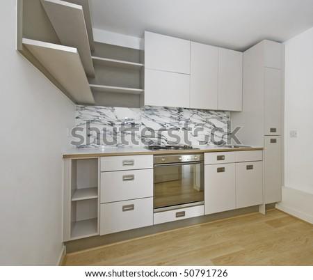 modern corner shape kitchen unit in beige color