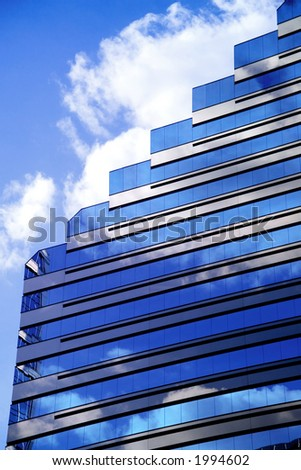 Modern Corporate building with blue sky and clouds