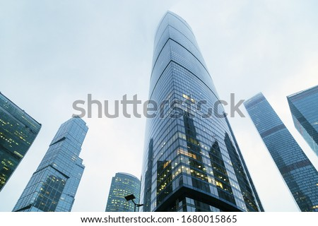 Modern corporate buildings against blue sky. High-rise buildings in Moscow city. Blue colored skyscrapers of business center.