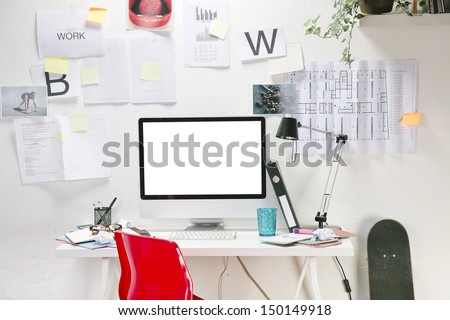 Modern creative workspace with computer and red chair. The office of a creative worker.