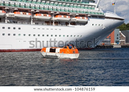 Modern Cruise Ship during the exercise of lifeboats.