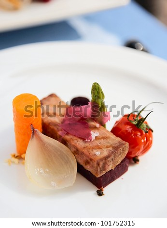 Modern cuisine dish with meat and vegetables