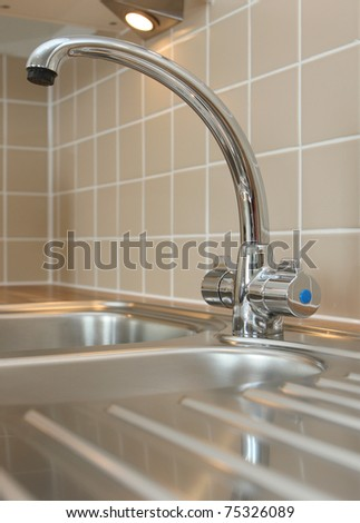 Modern curved mixer tap