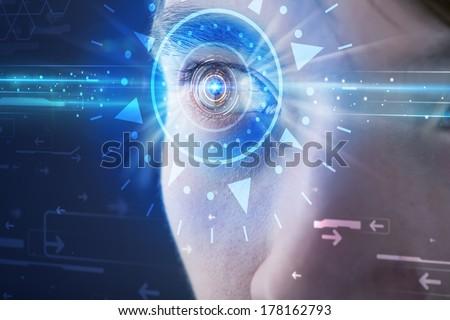 Modern cyber man with technolgy eye looking into blue iris