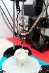 Modern 3D printer printing resin figure. Three-dimensional technology