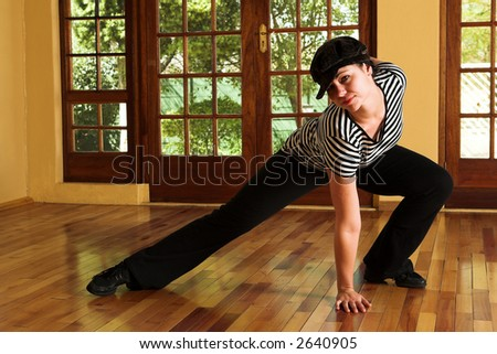 Modern Dancer in black Hat and striped top - Practicing in Studio