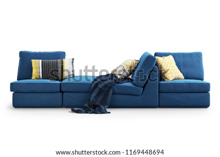 Modern dark blue textile sofa with colored pillows and plaid on white background with shadows. Scandinavian style. Modern style. Dark blue fabric upholstery. 3d render