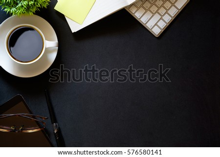 Modern dark surface office desk table with computer and cup of coffee. Hero Header Concept with Copy space.